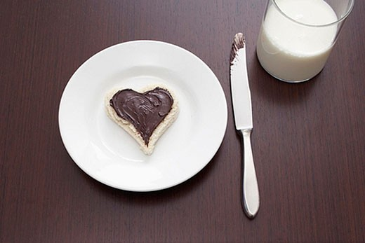 Stock Photo: 1669R-5820 still life of sandwich with spread cut out in shape of heart on plate and glass of milk