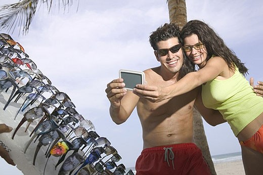 Stock Photo: 1669R-7364 Couple trying on sunglasses