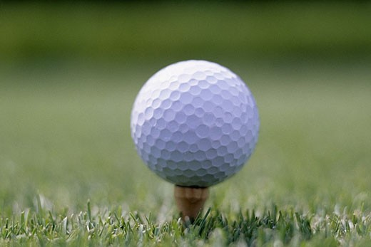 Stock Photo: 1669R-7891 Golf ball sitting on a tee