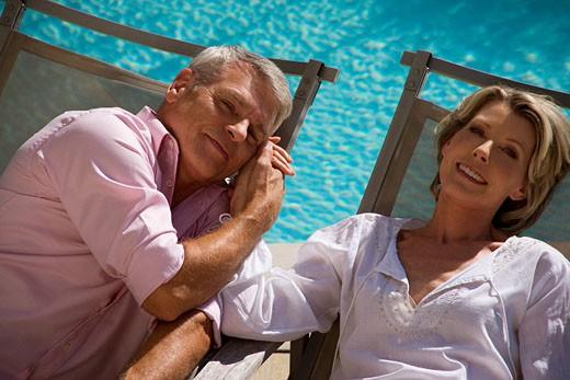 headshot of mature couple on sun loungers : Stock Photo