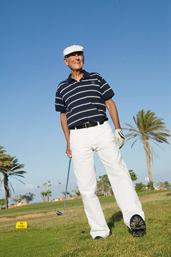 Stock Photo: 1669R-9086 portrait of mature golf player wearing flat cap
