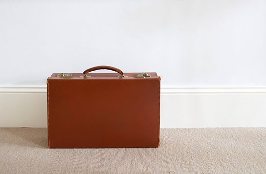 still life of single brown briefcase : Stock Photo