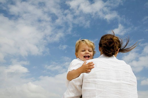 mother hugging her young son : Stock Photo