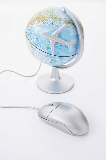 Stock Photo: 1669R-9539 still life of computer mouse globe and toy airplane