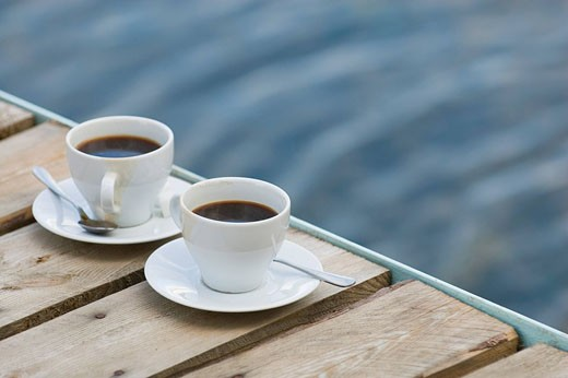 Stock Photo: 1669R-9760 still life of two coffee cups on wooden pier