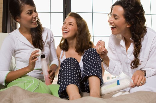 Close-up of three young women laughing : Stock Photo