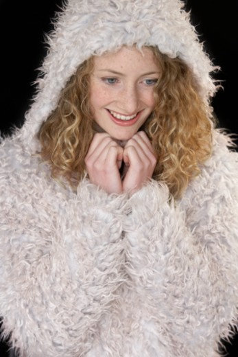 Teenage girl (15-17) wearing hooded coat, smiling : Stock Photo
