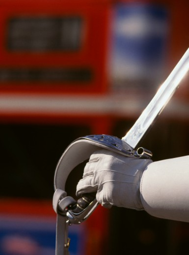 England, London Queen's Horseguard officer, close-up of hand and sword : Stock Photo