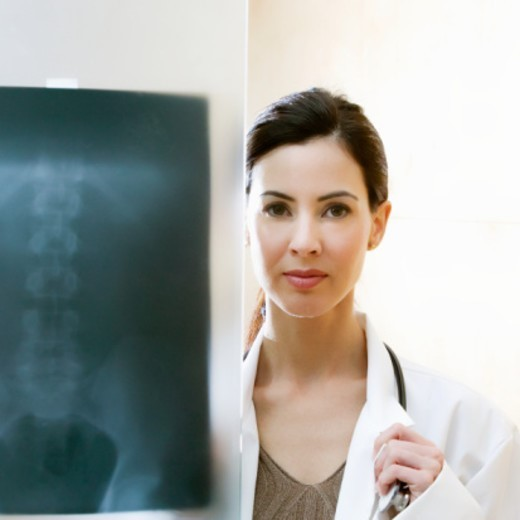 Stock Photo: 1672R-11695 Female doctor with xray, portrait