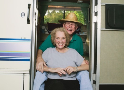 Stock Photo: 1672R-11703 Senior couple at entrance to recreational vehicle, portrait