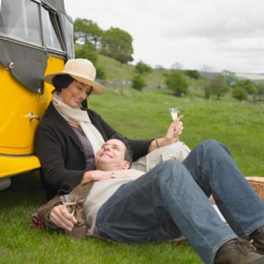 Mature couple having picnic, smiling : Stock Photo