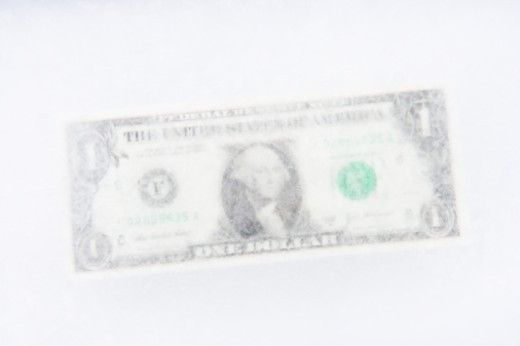 US one dollar bill frozen in block of ice : Stock Photo