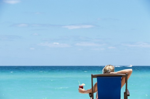 USA, Florida, Miami Beach, woman in beach chair with drink, rear view : Stock Photo