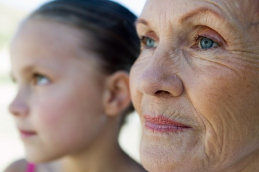Mature woman and granddaughter (8-10), focus on mature woman : Stock Photo