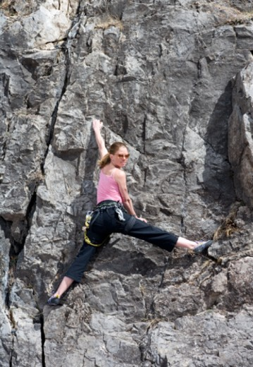 Woman rock climbing, portrait : Stock Photo