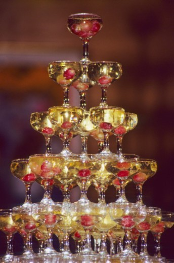 Stock Photo: 1672R-13348 Champagne glass pyramid, glasses containing champagne and grapes
