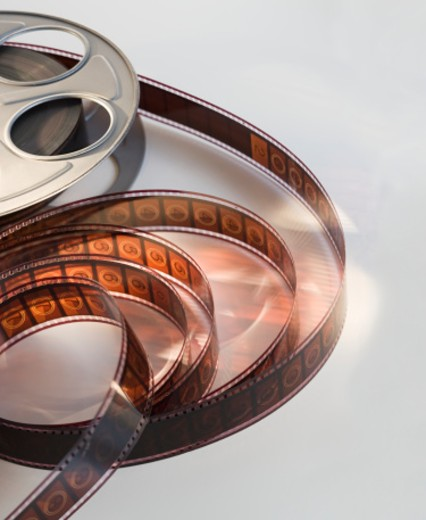 Stock Photo: 1672R-14516 Celluloid film and film reel, close-up