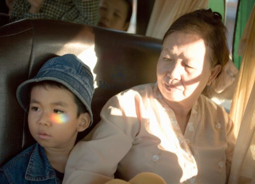 Grandmother with grandson (4-5) in van, close-up : Stock Photo