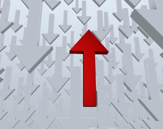 Red arrow pointing upwards surrounded by many arrows pointing down (digital) : Stock Photo