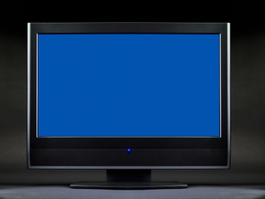 Television with blue screen, close-up : Stock Photo