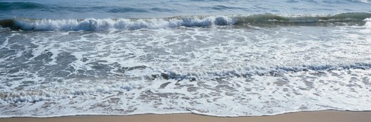 France, Cote-d'Azur, waves lapping onto beach, close-up : Stock Photo