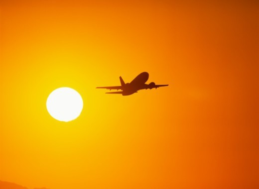 Jet aircraft flying, sunset : Stock Photo