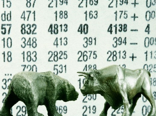 Stock Photo: 1672R-17205 Bull and Bear with financial data in background