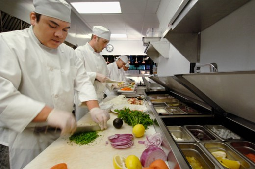 Team of chefs preparing food : Stock Photo