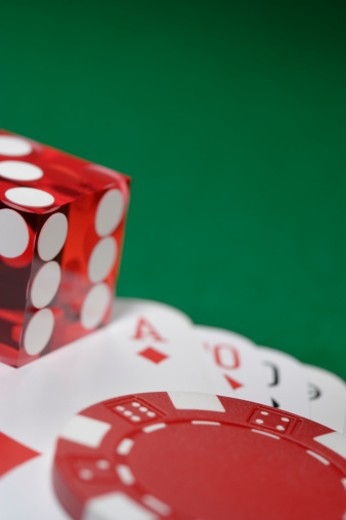 Die, playing cards and gambling chip on green table : Stock Photo