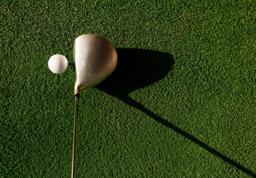 Golf ball and club on grass, elevated view : Stock Photo