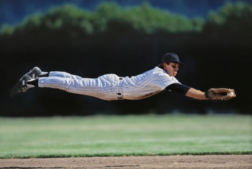 Stock Photo: 1672R-18876 Baseball player diving to catch ball, side view