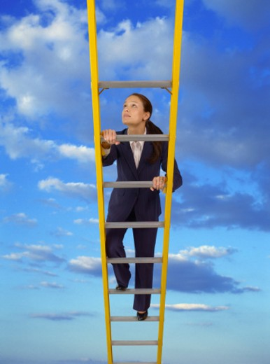 Young woman climbing ladder in sky, (digital composite) : Stock Photo