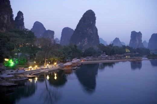China, Guangxi Province, Guilin, Yangshuo, Yulong River, bamboo rafts at dusk : Stock Photo