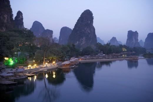 Stock Photo: 1672R-21284 China, Guangxi Province, Guilin, Yangshuo, Yulong River, bamboo rafts at dusk