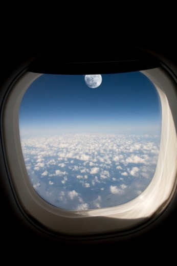 Stock Photo: 1672R-22324 Moonrise seen through airplane window (Digital Composite)