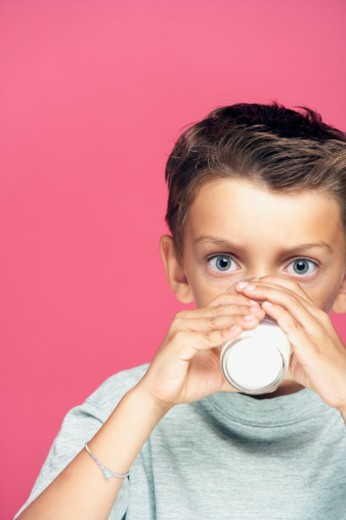 Stock Photo: 1672R-23591 Boy (6-7) drinking milk, portrait