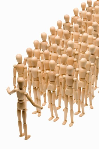 Group of artist dolls standing in formation : Stock Photo