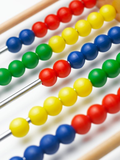 Abacus with multicolored beads, detail, studio shot : Stock Photo