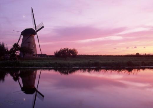 Netherlands, Kinderdijk, windmill at sunset : Stock Photo