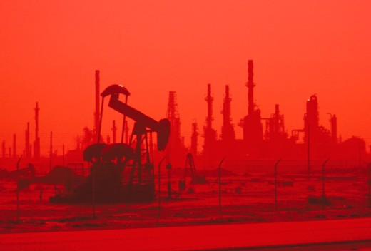 Stock Photo: 1672R-24766 USA, California, refinery oil pump at sunset