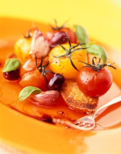 Roasted vine tomato bruschetta : Stock Photo