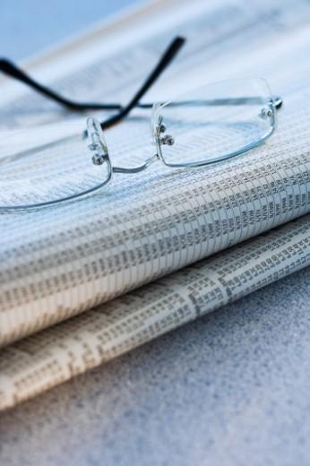 Stock Photo: 1672R-25305 Eyeglasses on newspaper