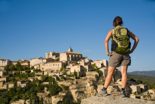 Stock Photo: 1672R-25358 France, Village of Gordes, woman looking at village, rear view