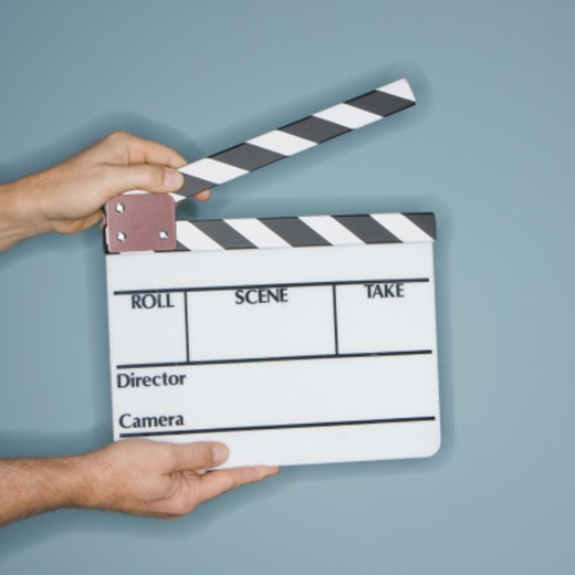 Person holding clapperboard, close-up of hands : Stock Photo