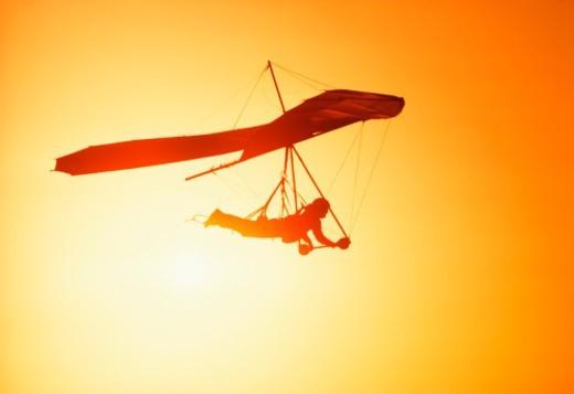 Man hang-gliding at sunset. California, USA. : Stock Photo