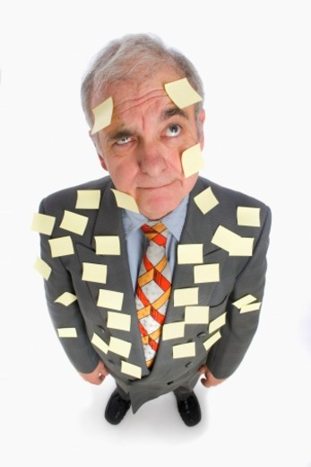 Stock Photo: 1672R-28575 Senior business man covered with adhesive notes