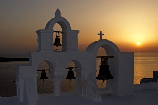 Greece, Santorini, Oia, church bell tower against sunset sky : Stock Photo
