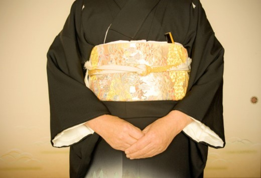 Stock Photo: 1672R-30190 Detail of Mid Section of Kimono with Held Hands