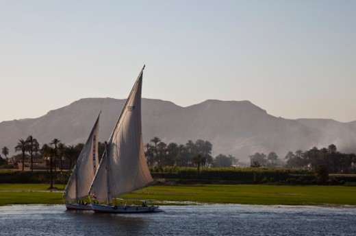 Stock Photo: 1672R-30269 a pair of traditional Feluccas sailing along the Nile near Luxor