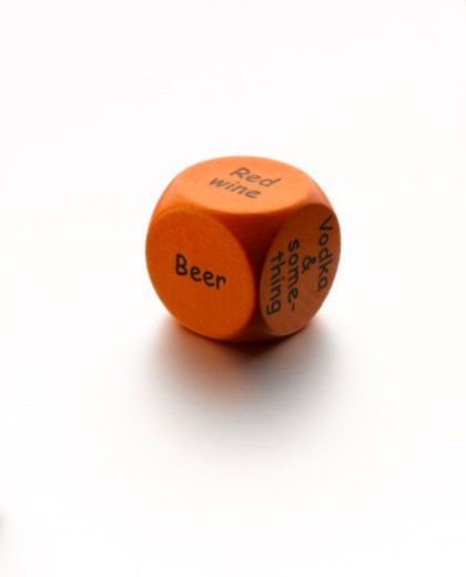 A single dice with different alcohol options on the various facets : Stock Photo